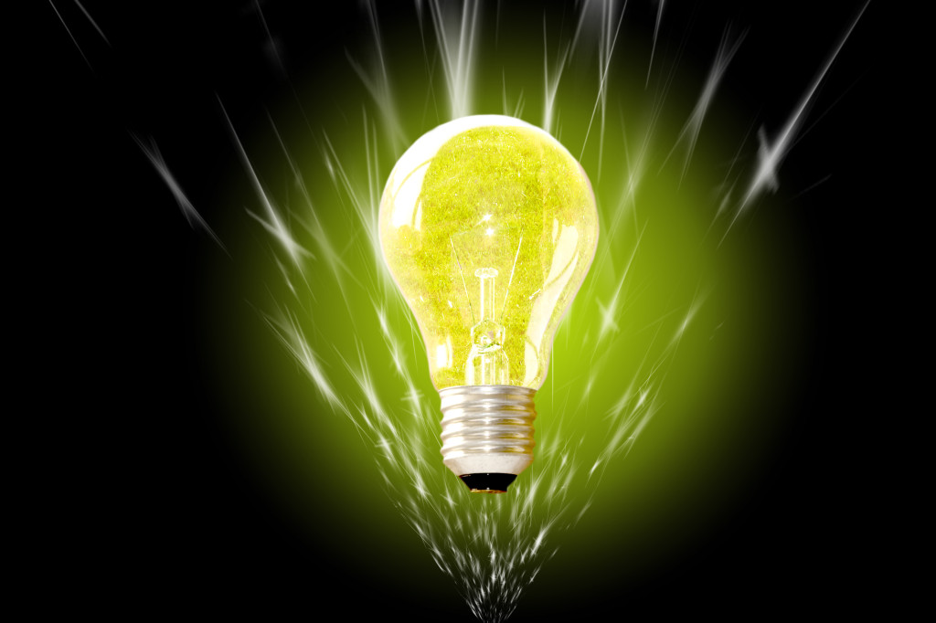 A high contrast composition of a ightbulb over a dark background