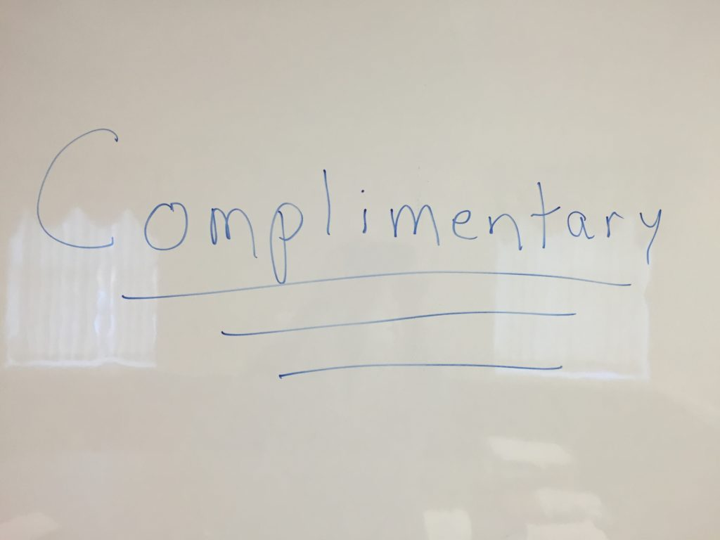 "hand written word ""Complimentary"""